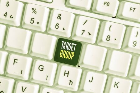 Handwriting text Target Group. Conceptual photo Particular showing that an advertisement intended to reach to White pc keyboard with empty note paper above white background key copy space