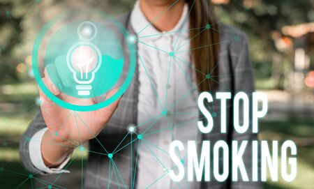 Handwriting text Stop Smoking. Conceptual photo Discontinuing or stopping the use of tobacco addiction Female human wear formal work suit presenting presentation use smart device 版權商用圖片