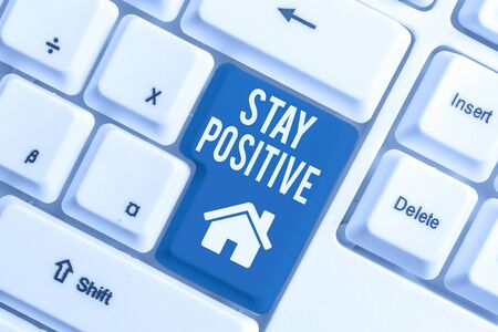 Conceptual hand writing showing Stay Positive. Concept meaning Engage in Uplifting Thoughts Be Optimistic and Real White pc keyboard with note paper above the white background