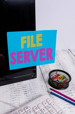 Writing note showing File Server. Business concept for device which controls access to separately stored data Note paper taped to black computer screen near keyboard and stationary Stock fotó