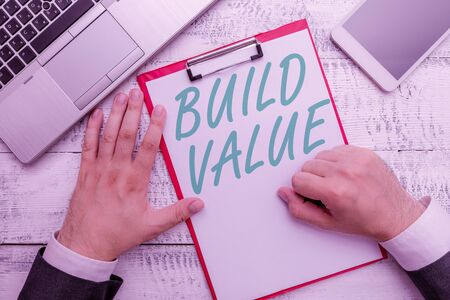Conceptual hand writing showing Build Value. Concept meaning efficient enough way that it will generate profit after cost Stock fotó