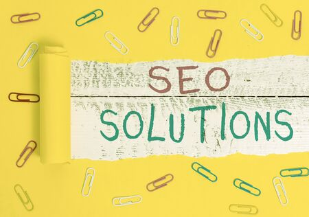 Writing note showing Seo Solutions. Business concept for Search Engine Result Page Increase Visitors by Rankings