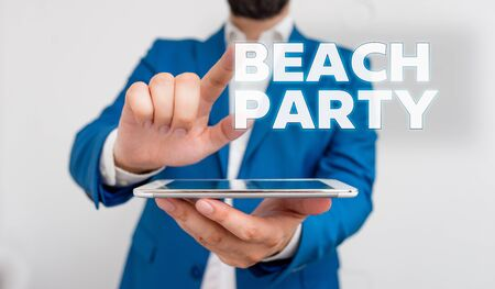 Word writing text Beach Party. Business photo showcasing small or big festival held on sea shores usually wearing bikini Businessman with pointing finger in front of him Foto de archivo