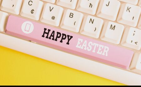 Conceptual hand writing showing Happy Easter. Concept meaning Christian feast commemorating the resurrection of Jesus White pc keyboard with note paper above the white background Stock Photo - 130154837
