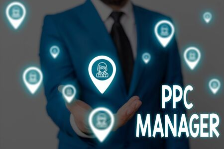 Handwriting text Ppc Manager. Conceptual photo which advertisers pay fee each time one of their ads is clicked Male human wear formal work suit presenting presentation using smart device