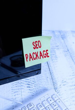 Word writing text Seo Package. Business photo showcasing practice of search engine optimization increase amount visitors Notation paper taped to black computer monitor screen near white keyboard