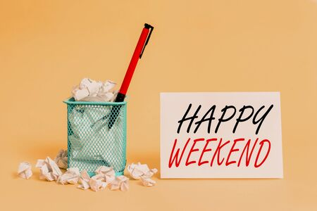 Text sign showing Happy Weekend. Business photo showcasing Cheerful rest day Time of no office work Spending holidays crumpled paper trash and stationary with note paper placed in the trash can Stock fotó