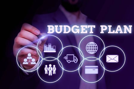 Handwriting text writing Budget Plan. Conceptual photo financial schedule for a defined period of time usually year Male human wear formal work suit presenting presentation using smart device