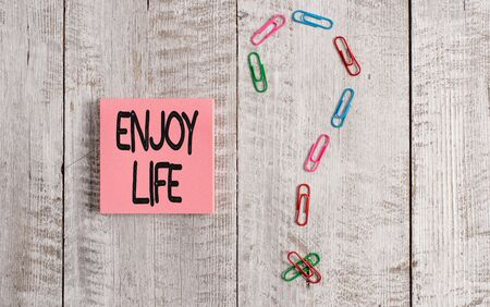 Writing note showing Enjoy Life. Business concept for Any thing, place,food or demonstrating, that makes you relax and happy Pastel colour note paper placed next to stationary above wooden table Reklamní fotografie