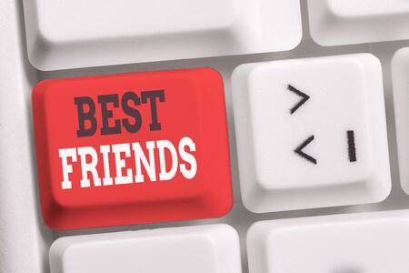 Handwriting text writing Best Friends. Conceptual photo A demonstrating you value above other demonstratings Forever buddies White pc keyboard with empty note paper above white background key copy space