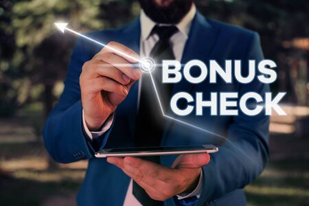 Writing note showing Bonus Check. Business concept for something in addition to what is expected or strictly due