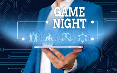Conceptual hand writing showing Game Night. Concept meaning event in which folks get together for the purpose of getting laid Male wear formal work suit presenting presentation smart device
