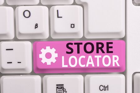 Writing note showing Store Locator. Business concept for to know the address contact number and operating hours White pc keyboard with note paper above the white background