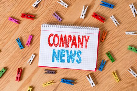 Conceptual hand writing showing Company News. Concept meaning Latest Information and happening on a business Corporate Report Colored crumpled papers wooden floor background clothespin