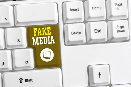 Text sign showing Fake Media. Business photo text An formation held by brodcasters which we cannot rely on White pc keyboard with empty note paper above white background key copy space