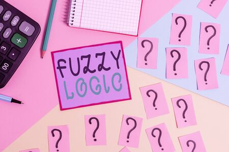 Handwriting text Fuzzy Logic. Conceptual photo checks for extent of dirt and grease amount of soap and water Mathematics stuff and writing equipment above pastel colours background