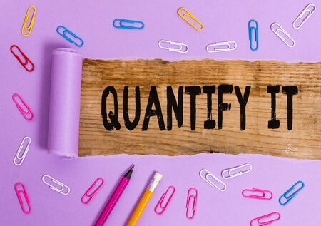 Writing note showing Quantify It. Business concept for Measure the size or amount of something and express in numbers Stock fotó