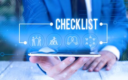 Word writing text Checklist. Business photo showcasing List down of the detailed activity as guide of doing something Male human wear formal work suit presenting presentation using smart device