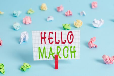Conceptual hand writing showing Hello March. Concept meaning musical composition usually in duple or quadruple with beat Colored clothespin rectangle shaped paper blue background
