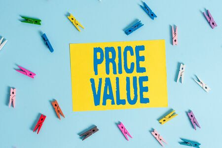 Handwriting text Price Value. Conceptual photo strategy which sets cost primarily but not exclusively Colored clothespin rectangle shaped reminder paper light blue background Фото со стока