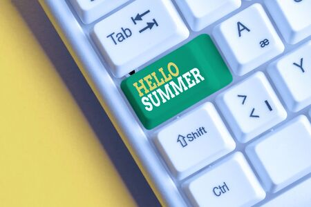 Conceptual hand writing showing Hello Summer. Concept meaning Welcoming the warmest season of the year comes after spring White pc keyboard with note paper above the white background