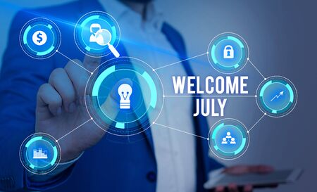 Word writing text Welcome July. Business photo showcasing Calendar Seventh Month 31days Third Quarter New Season Male human wear formal work suit presenting presentation using smart device