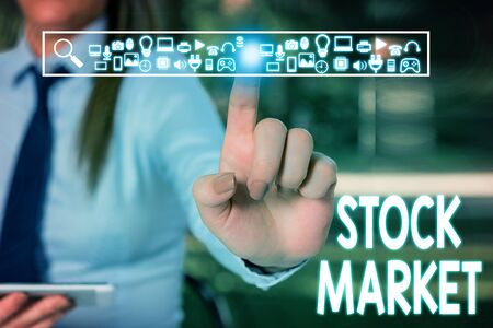 Handwriting text writing Stock Market. Conceptual photo Particular market where stocks and bonds are traded or exhange Woman wear formal work suit presenting presentation using smart device