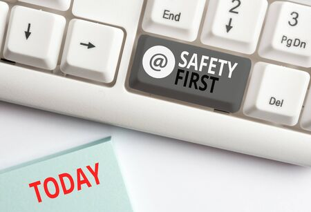Word writing text Safety First. Business photo showcasing Avoid any unnecessary risk Live Safely Be Careful Pay attention White pc keyboard with empty note paper above white background key copy space 스톡 콘텐츠