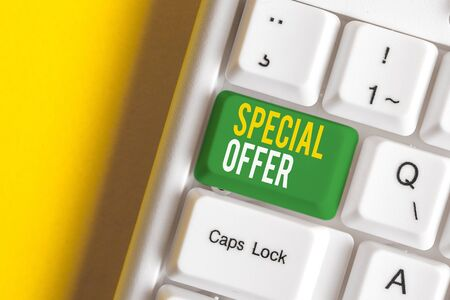 Handwriting text writing Special Offer. Conceptual photo Discounted price Markdown Promotional Items Crazy Sale White pc keyboard with empty note paper above white background key copy space
