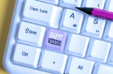 Writing note showing Happy Weekend. Business concept for Cheerful rest day Time of no office work Spending holidays White pc keyboard with note paper above the white background