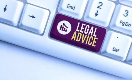 Writing note showing Legal Advice. Business concept for Lawyer opinion about law procedure in a particular situation White pc keyboard with note paper above the white background