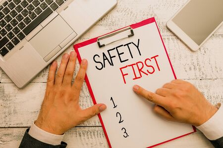 Writing note showing Safety First. Business concept for Avoid any unnecessary risk Live Safely Be Careful Pay attention