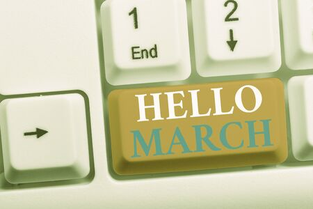 Writing note showing Hello March. Business concept for musical composition usually in duple or quadruple with beat White pc keyboard with note paper above the white background