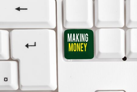 Conceptual hand writing showing Making Money. Concept meaning Giving the opportunity to make a profit Earn financial support White pc keyboard with note paper above the white background