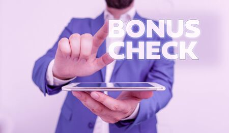 Word writing text Bonus Check. Business photo showcasing something in addition to what is expected or strictly due Businessman with pointing finger in front of him