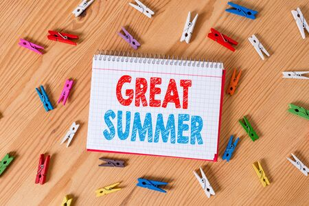 Conceptual hand writing showing Great Summer. Concept meaning Having Fun Good Sunshine Going to the beach Enjoying outdoor Colored crumpled papers wooden floor background clothespin Zdjęcie Seryjne