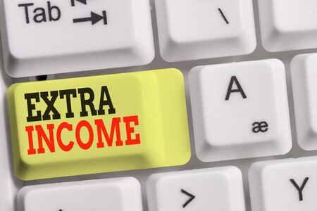 Handwriting text Extra Income. Conceptual photo Additional fund received or earned from a non regular basis White pc keyboard with empty note paper above white background key copy space