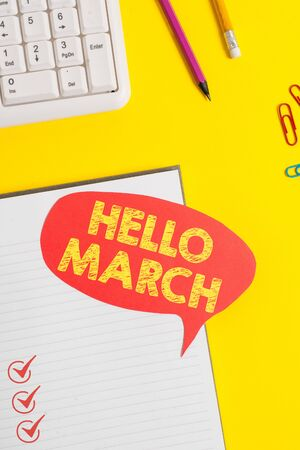 Text sign showing Hello March. Business photo showcasing musical composition usually in duple or quadruple with beat Pink empty paper on the yellow table with pencil Zdjęcie Seryjne