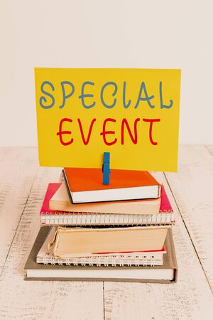 Conceptual hand writing showing Special Event. Concept meaning Function to generate money for non profit a Crowded Occassion pile stacked books notebook pin color reminder white wooden