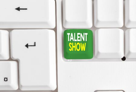 Conceptual hand writing showing Talent Show. Concept meaning Competition of entertainers show casting their perforanalysisces White pc keyboard with note paper above the white background