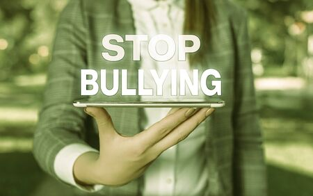Word writing text Stop Bullying. Business photo showcasing Fight and Eliminate this Aggressive Unacceptable Behavior Outdoor scene with business woman holds lap top with touch screen
