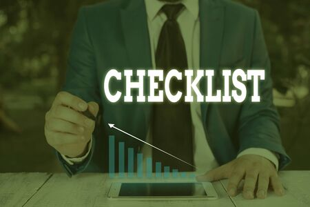 Handwriting text writing Checklist. Conceptual photo List down of the detailed activity as guide of doing something Male human wear formal work suit presenting presentation using smart device Stockfoto