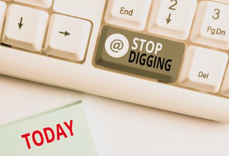 Word writing text Stop Digging. Business photo showcasing Prevent Illegal excavation quarry Environment Conservation White pc keyboard with empty note paper above white background key copy space