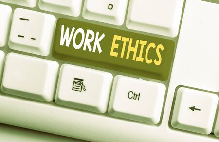 Conceptual hand writing showing Work Ethics. Concept meaning A set of values centered on the importance of doing work White pc keyboard with note paper above the white background