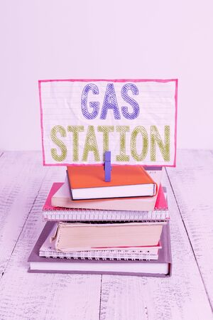 Word writing text Gas Station. Business photo showcasing for servicing motor vehicles especially with gasoline and oil pile stacked books notebook pin clothespin colored reminder white wooden Stok Fotoğraf