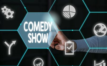 Word writing text Comedy Show. Business photo showcasing Funny program Humorous Amusing medium of Entertainment Male human wear formal work suit presenting presentation using smart device