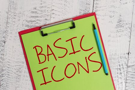 Handwriting text Basic Icons. Conceptual photo pictogram or ideogram displayed on a computer screen or phone Colored clipboard blank paper sheet marker old wooden vintage background