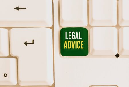 Conceptual hand writing showing Legal Advice. Concept meaning Lawyer opinion about law procedure in a particular situation White pc keyboard with note paper above the white background