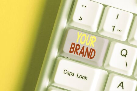 Word writing text Your Brand. Business photo showcasing A name of any kind that is impacted to something as trademark White pc keyboard with empty note paper above white background key copy space