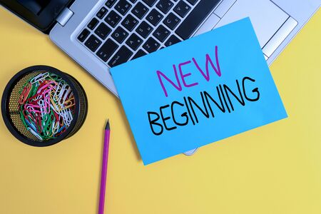 Word writing text New Beginning. Business photo showcasing Different Career or endeavor Starting again Startup Renew Trendy metallic laptop small paper sheet pencil clips colored background